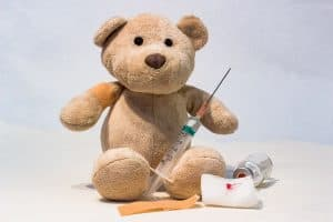 teddy bear with vaccine injection