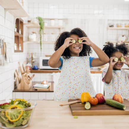 Two little black girls cooking